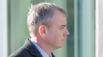 Dennis Oland heads to the Law Courts where he was found guilty of second degree murder in the death of his father, Richard Oland, in Saint John, N.B. on Saturday, Dec. 19, 2015. (Andrew Vaughan / THE CANADIAN PRESS)