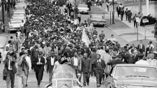 In this March 17, 1965 file photo, thousands of demonstrators march to the Montgomery, Ala. courthouse behind Dr. Martin Luther King Jr. to protest treatment of demonstrators by police during an attempted march. At foreground center in white shirt is Andrew Young. (AP / File)