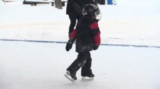 A little boy glides along a skating rink in this undated file photo.
