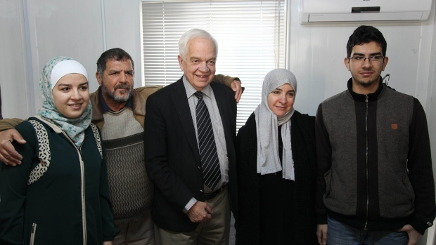 John McCallum says Canada to doule refugee intake