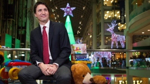 Prime Minister Justin Trudeau appears on CTV Toronto's Toy Mountain campaign at the Eaton Centre Shopping Mall in Toronto on Monday, Dec. 14, 2015. (Chris Young / THE CANADIAN PRESS)