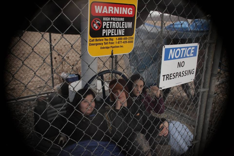 Protesters temporarily shut down Enbridge's Line 9 at a site in Sarnia, Ont. on Monday, Dec. 21, 2015. (The Indignants / Facebook)