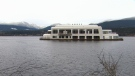 The derelict vessel, dubbed McBarge, is being towed from its current location on Burrard Inlet in Burnaby, B.C.