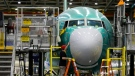 In this photo taken Monday, Dec. 7, 2015, a worker inspects the nose cone of the second Boeing 737 MAX airplane being built in Renton, Wash. (Ted S. Warren/AP)