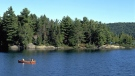 People canoe in Algonquin Provincial Park in Ontario, Canada, in this 2001 photo. (Ontario Tourism 2005 / The Canadian Press)