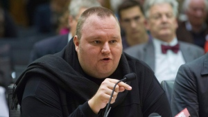 Internet entrepreneur Kim Dotcom speaks during the Intelligence and Security select committee hearing at Parliament in Wellington, New Zealand on Wednesday, July 3, 2013. (Mark Mitchell / New Zealand Herald)