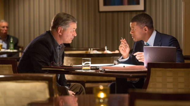 """This photo provided by Columbia Pictures shows, Alec Baldwin, from left, as Dr. Julian Bailes, and Will Smith as Dr. Bennet Omalu, in a scene from Columbia Pictures' """"Concussion."""" (Melinda Sue Gordon/Columbia Pictures via AP)"""
