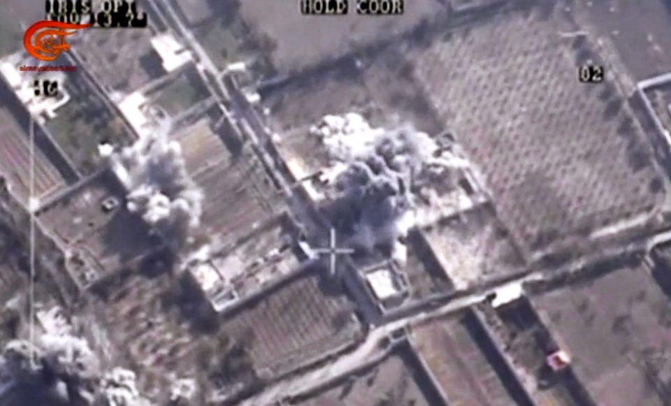 This image made from video made available on Saturday, Dec. 26, 2015, by Al-Mayadeen, government-controlled Syrian Television, which has been verified and is consistent with other AP reporting shows, drone footage allegedly showing Syrian army airstrikes targeting Zahran Alloush, the head of the Army of Islam group near Damascus, Syria. (Al-Mayadeen via AP video)