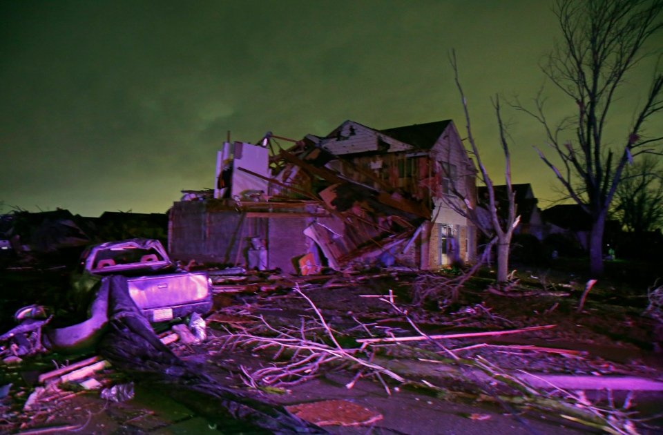 Debris lies on the ground near a home that was heavily damaged by a tornado in Rowlett, Texas, Saturday, Dec. 26, 2015. (Guy Reynolds/The Dallas Morning News via AP)