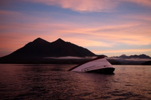 The bow of the Leviathan II, a whale-watching boat owned by Jamie's Whaling Station, is seen near Vargas Island looking towards Cat Face Island as it waits to be towed into town for inspection in Tofino, B.C.,Tuesday, October 27, 2015. (Chad Hipolito/THE CANADIAN PRESS)
