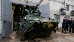 Armored vehicles comes out from gate of a tank factory in Kiev, Ukraine, Wednesday, Dec. 23, 2015. (AP /Sergei Chuzavkov)