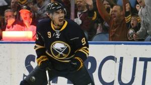 Buffalo Sabres' Evander Kane celebrates a goal in Buffalo, N.Y., on Friday, Dec. 4, 2015. (AP Photo/Gary Wiepert)