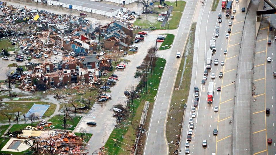 Traffic backs up along I-30, near a site of Saturday's tornado in Garland, Texas, Sunday, Dec. 27, 2015. (G.J. McCarthy/The Dallas Morning News via AP) MANDATORY CREDIT