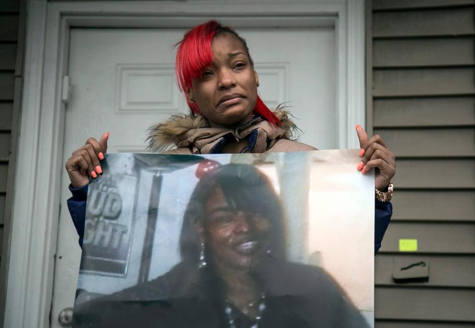Latonya Jones, 19, holds a photo of her mother, Bettie Jones, during a vigil on Sunday, Dec. 27, 2015, in Chicago. (Ashlee Rezin/Chicago Sun-Times via AP)