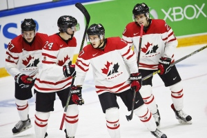 From left: Canada's Mitchell Stephens, Travis Dermott, Travis Konecny and Roland McKeown celebrate the 4-1 goal during the 2016 IIHF World Junior Ice Hockey Championship match between Canada and Denmark in Helsinki, Finland, Monday, Dec. 28, 2015. (Roni Rekomaa/Lehtikuva via AP)