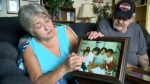 Thelma and Joe Favel look at a picture of their niece, Tina Fontaine, after police announced they had charged a suspect with her murder.