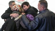 Shergo Kurdi hugs his aunt Tima Kurdi in Vancouver