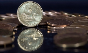 The Canadian dollar coin, the Loonie, is displayed Friday, January 30, 2015 in Montreal. (Paul Chiasson/THE CANADIAN PRESS)