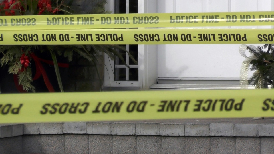 Police tape marks a crime scene in Peterborough, Ont. on Monday, Dec. 28, 2015. (Harrison Perkins / CTV Toronto)