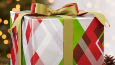 This photo provided by Crate and Barrel shows a package in holiday plaid gift wrap. (Crate and Barrel via AP)
