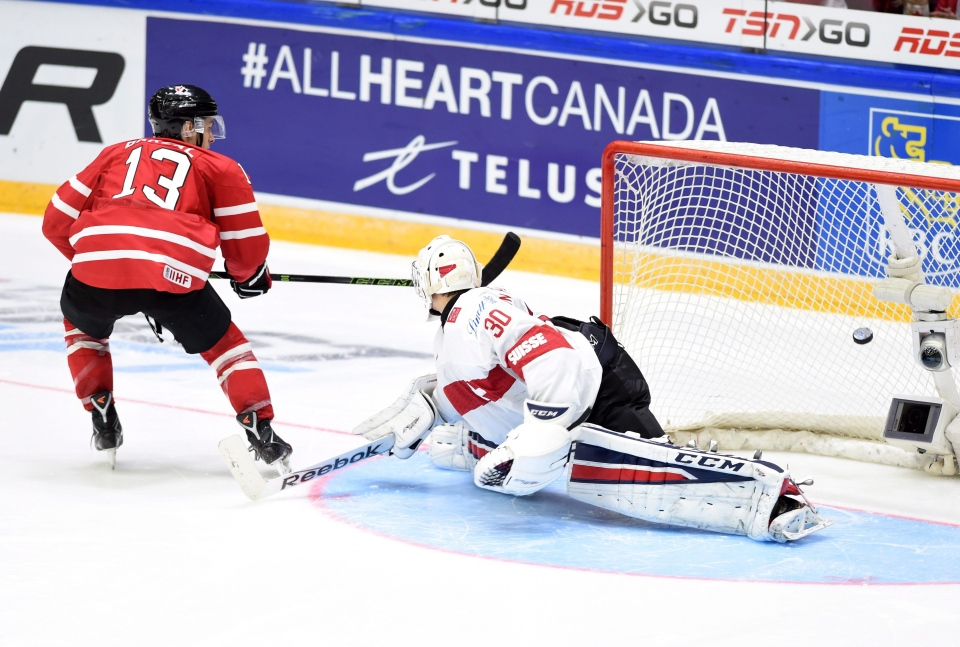 Canada's Mathew Barzal puts the game-winning shot past Switzerland's Joren van Pottelberghe during a shootout in preliminary round hockey action at the IIHF World Junior Championship in Helsinki, Finland on Tuesday, Dec. 29, 2015.