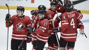 Canada's Travis Dermott (L), Travis Konecny (17), Lawson Crouse (28) and Haydn Fleury (4) celebrate after winning the 2016 World Junior Hockey Championships tournament match between Switzerland and Canada in Helsinki, Finland, Tuesday, Dec. 29, 2015. (Heikki Saukkomaa / Lehtikuva via AP)