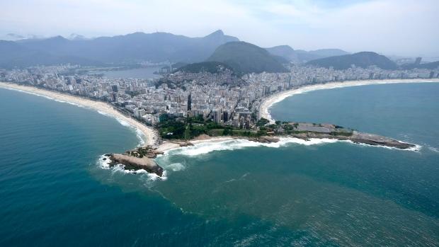 The beaches of Ipanema, left, and Copacabana, right, in Rio de Janeiro, are shown on Oct. 9, 2015. (AP Photo/David J. Phillip)