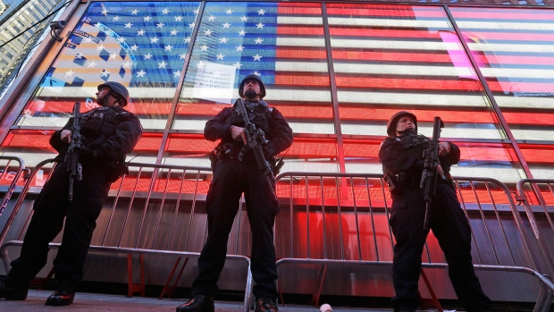 Heavily-armed New York City police officers with the Strategic Response Group stand guard at the armed forces recruiting center in New York's Times Square, Nov. 14, 2015. (AP / Mary Altaffer)