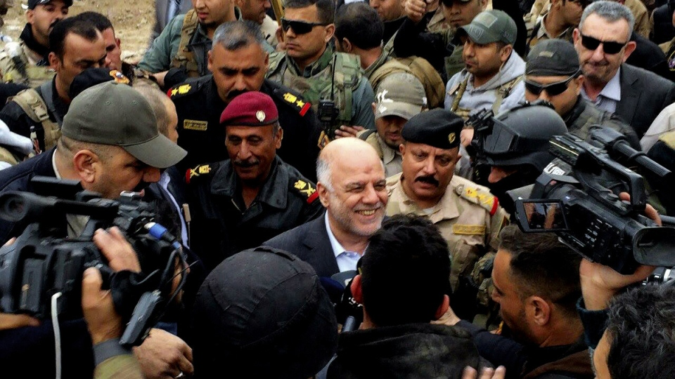 Iraqi Prime Minister Haider al-Abadi, centre, smiles as he tours the city of Ramadi after it was retaken by the security forces in Ramadi, 115 kilometres west of Baghdad, Iraq, Tuesday, Dec. 29, 2015. (AP Photo)