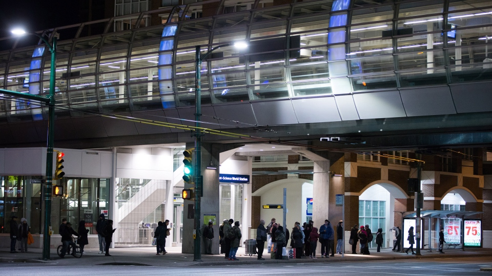 People stand outside the Main Street Skytrain station after the commuter train system was shut down to check for any possible damage to elevated guideways after an earthquake struck off the west coast late Tuesday night, in Vancouver, B.C., Wednesday December 30, 2015. (Darryl Dyck / THE CANADIAN PRESS)