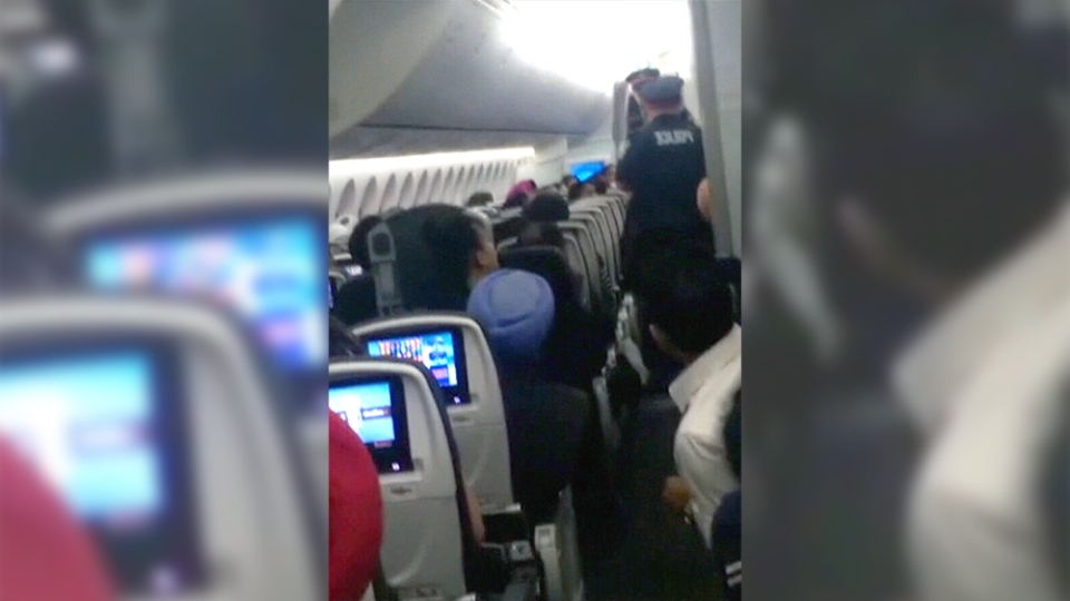 Police say a passenger aboard a flight to New Delhi assaulted a flight attendant.