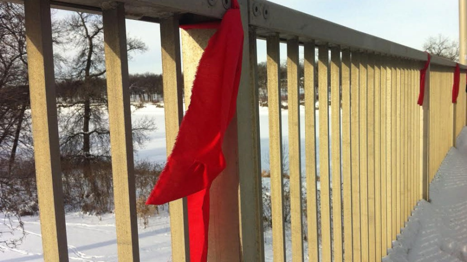 Red ribbons hang from the St. Vital Bridge for missing and murdered indigenous women.