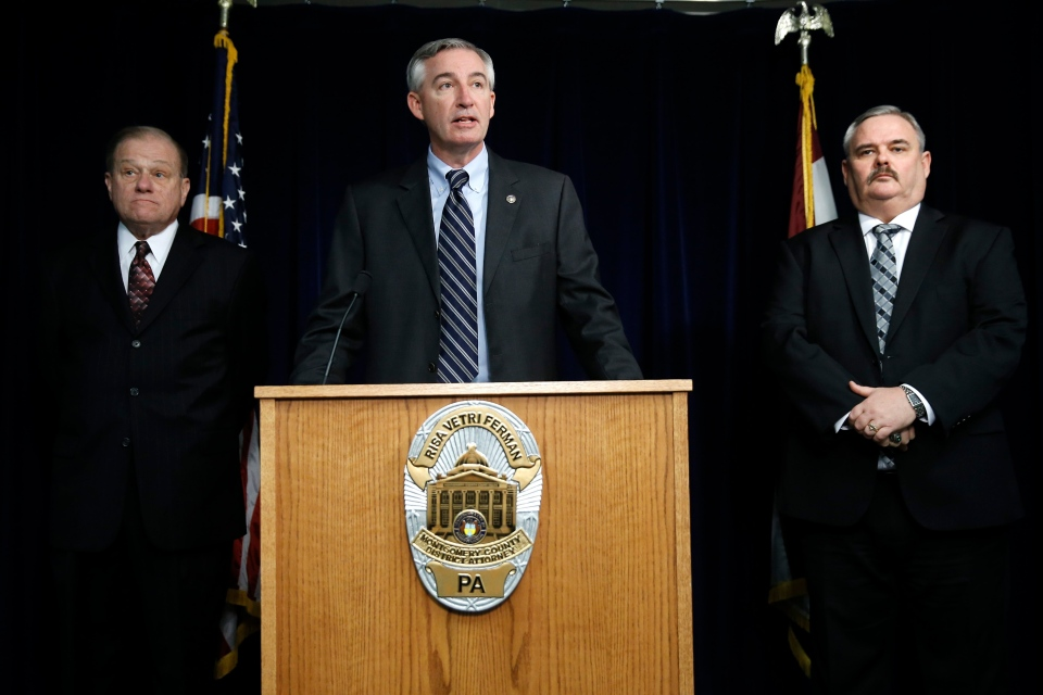 First Assistant District Attorney Kevin Steele, centre, announces a felony charge of aggravated indecent assault against comedian Bill Cosby at the Montgomery County detective bureau in Norristown, Pa., Wednesday, Dec. 30, 2015. (AP / Matt Rourke)