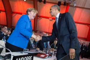 In this Monday, Nov. 30, 2015 file photo, German Chancellor Angela Merkel, left, is greeted by U.S. President Barack Obama after he delivered remarks during the COP21, United Nations Climate Change Conference, in Le Bourget, outside Paris. (AP / Evan Vucci)