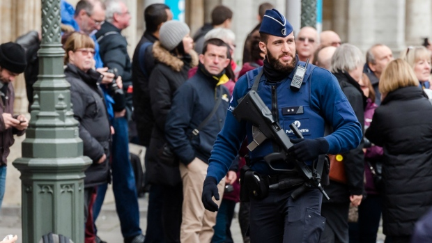 Police patrol the Grand Place in Brussels
