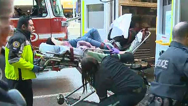 Calgary EMS personnel load a passenger who was injured on board an Air Canada flight from Shanghai onto an ambulance on December 30, 2015.