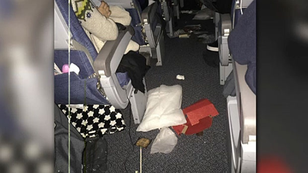 Items are seen strewn in the aisle on board an Air Canada flight from Shanghai that hit turbulence over Alaska.