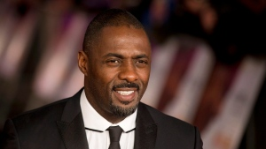 In this file photo photo dated Thursday, Dec. 5, 2013, British actor Idris Elba poses for photographers in London. (AP Photo/Matt Dunham, File)
