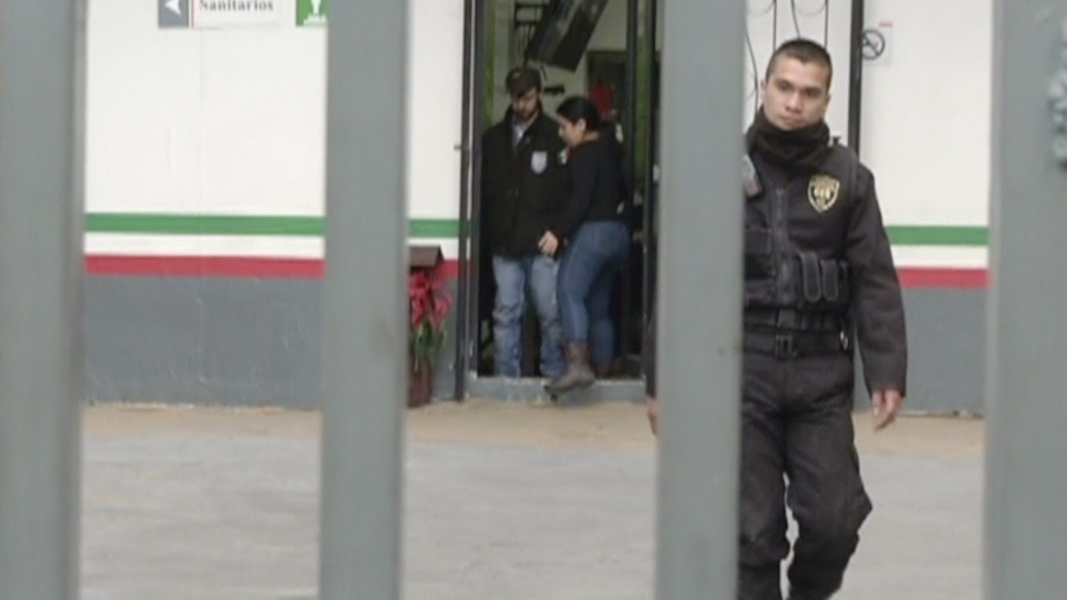 In this frame from video provided by TVAzteca, Ethan Couch, center, is led through a detention center in Guadalajara, Mexico, Wednesday, Dec. 30, 2015. (TV Azteca via AP)
