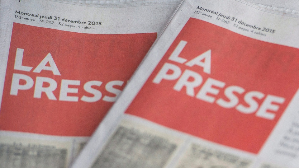 Copies of La Presse are shown in Montreal Thursday, December 31, 2015. The French language newspaper will cease to publish its weekday print edition as of January 1, 2016 to go digital only, with the exception of a Saturday print edition. THE CANADIAN PRESS/Graham Hughes
