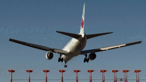 An Air Canada aircraft lands in this file image.