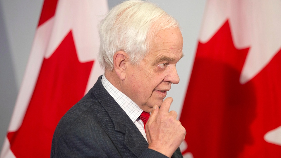 Immigration Minister John McCallum briefs journalists at the Welcome Centre in Toronto's Pearson Airport on Thursday, Dec. 31, 2015. (Chris Young / THE CANADIAN PRESS)