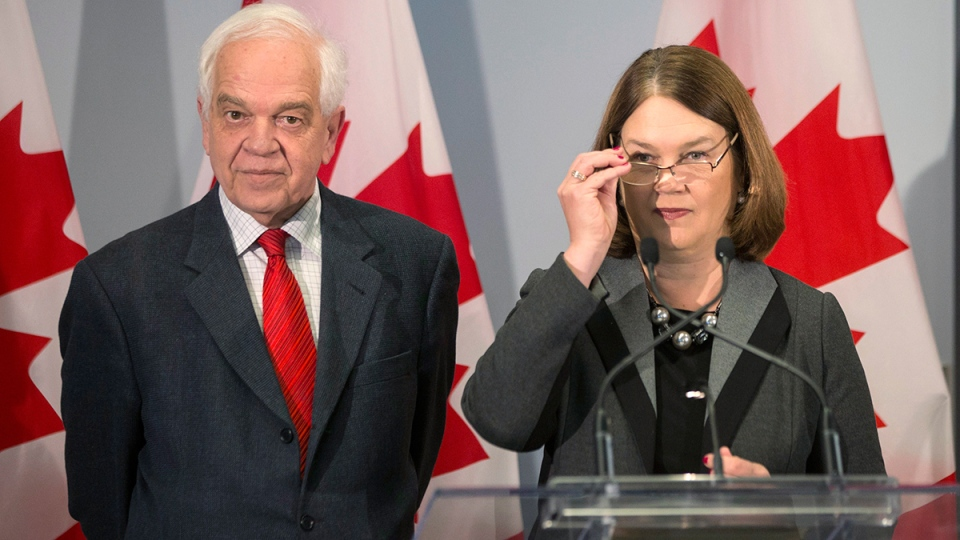 Immigration Minister John McCallum (left) and Health Minister Jane Philpott prepare to brief journalists at the Welcome Centre in Toronto's Pearson Airport on Thursday, Dec. 31, 2015. (Chris Young / THE CANADIAN PRESS)