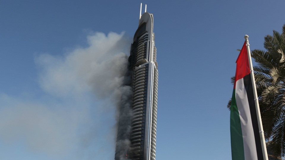Smoke billows from the Address Downtown skyscraper in Dubai, United Arab Emirates on Friday, Jan. 1, 2016. (AP / Jon Gambrell)