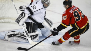 Los Angeles Kings goalie Jonathan Quick, left, blocks Calgary Flames' Sam Bennett during first period NHL hockey action in Calgary, Thursday, Dec. 31, 2015. (Jeff McIntosh / THE CANADIAN PRESS)