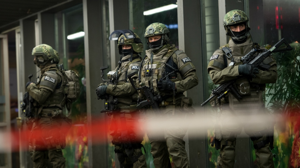 German special police stand in front of the Munich, southern Germany, main train station after police warned of 'imminent threat' of terror attack and ordered two train stations to be cleared on Thursday evening, Dec. 31, 2015. (Sven Hoppe / dpa)