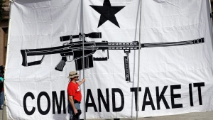 "A demonstrator helps hold a large ""Come and Take It"" banner at a rally in support of open carry gun laws at the Capitol, in Austin, Texas, Jan. 26, 2015. (AP / Eric Gay)"