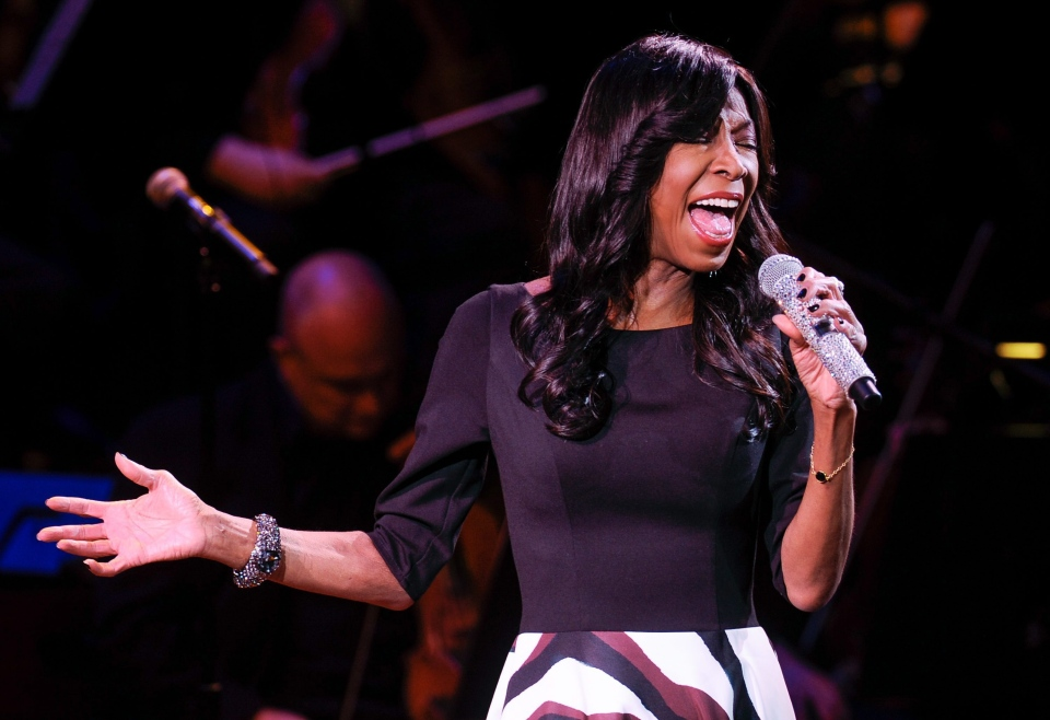 Singer Natalie Cole performs at 'An Evening of SeriousFun Celebrating the Legacy of Paul Newman,' hosted by the SeriousFun Children's Network at Avery Fisher Hall in New York, Monday, March 2, 2015. (Evan Agostini / Invision)