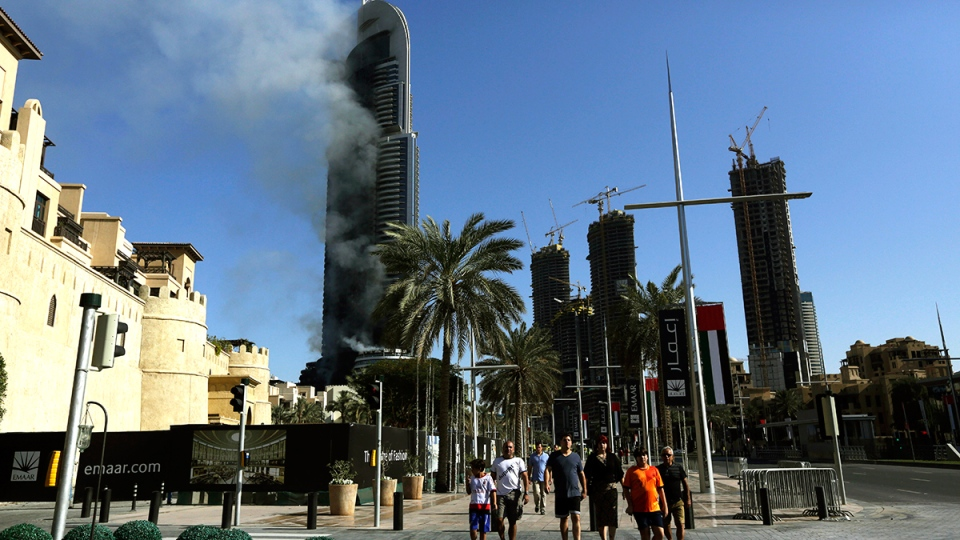 A fire burns in the Address Downtown skyscraper in Dubai, United Arab Emirates on Friday, Jan. 1, 2016. (AP / Sunday Alamba)