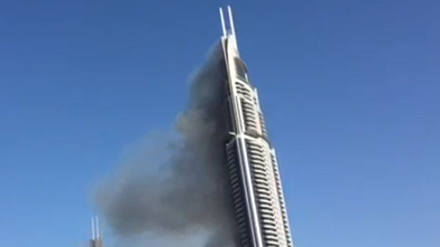 The Address Hotel in Dubai continues to smolder on January 1, 2016, after a massive fire tore through the 63-storey building on New Year's Eve.